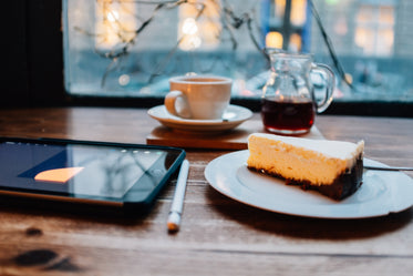 tablet and pen with coffee and cake