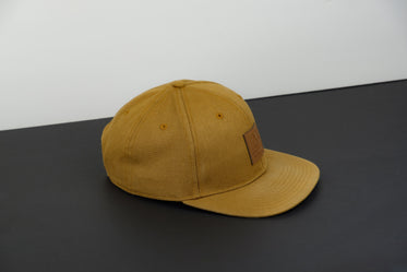 tan colored hat on monochrome background