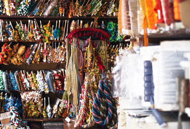 tassel and colored rope and ribbon in pigeon holes