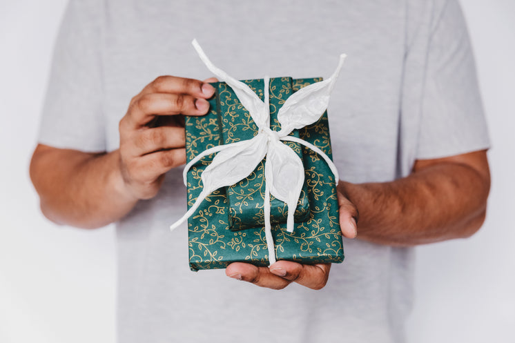 teal-gift-wrap-with-white-ribbon.jpg?wid