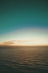 teal sky over calm evening waters