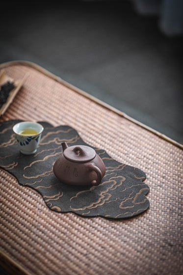 teapot and teacup on the table