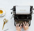 teatime design flat lay with typewriter