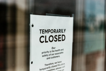 temporarily closed sign on door