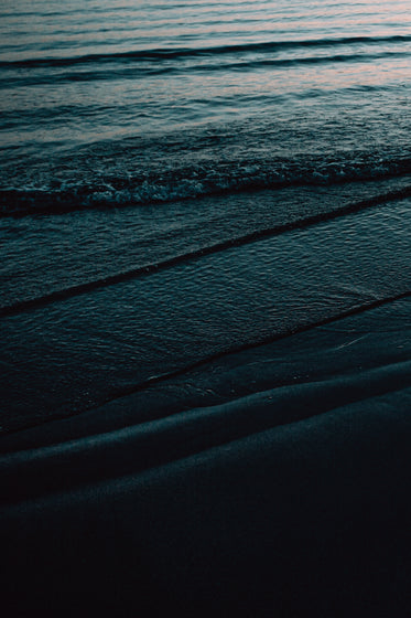 texture of dark waves on the shore