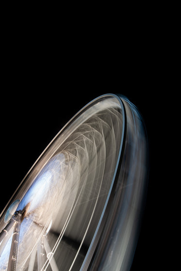 the blurry blades of a whizzing electric fan