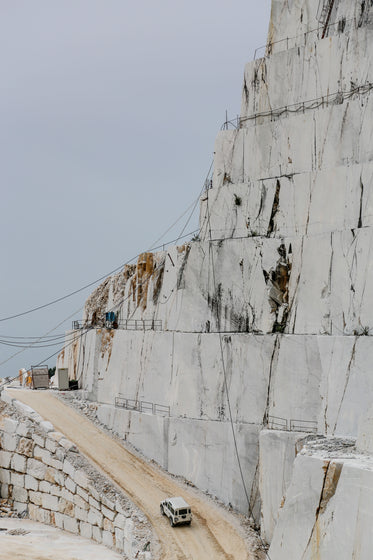 the edge of a quarry with white rocks