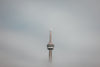 the toronto tower floats in the clouds