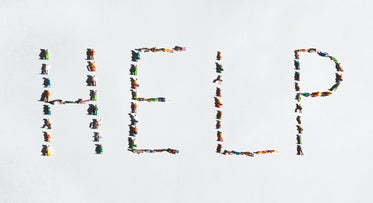 the word help spelled out with plastic miniatures