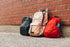 Browse Free HD Images of Three Children's Backpacks And A Brick Wall