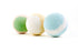 three colorful bath bombs