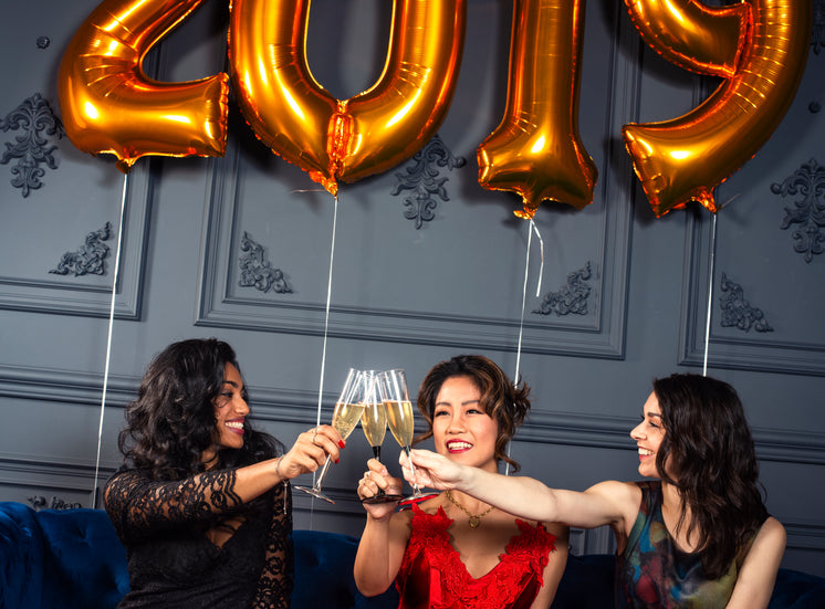 Three Friends Celebrate With A Champagne Toast
