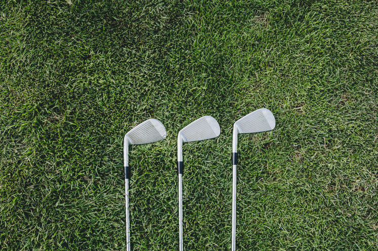 Three Golf Clubs On Green