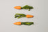 three paper woven carrots