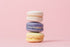 three pastel macarons