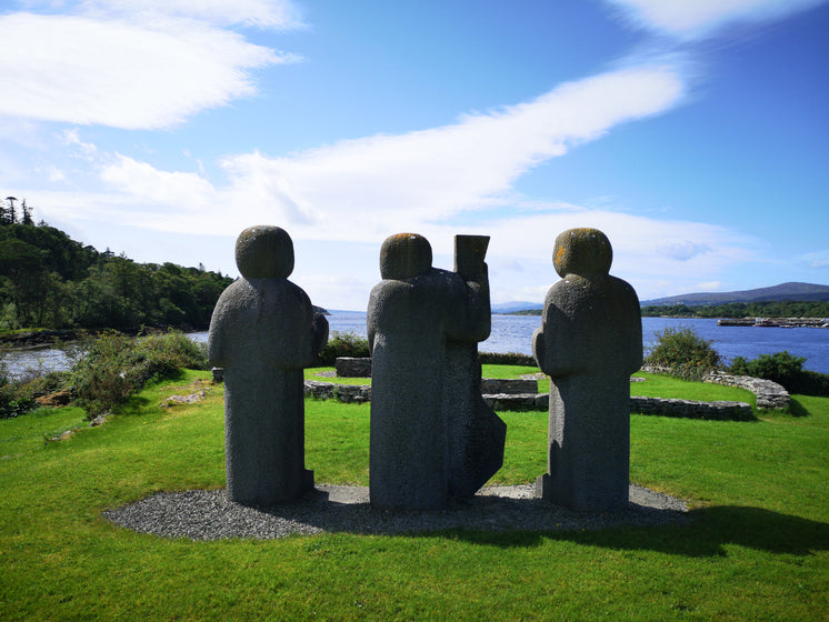 three-stone-figures-on-a-grassy-knoll-ov