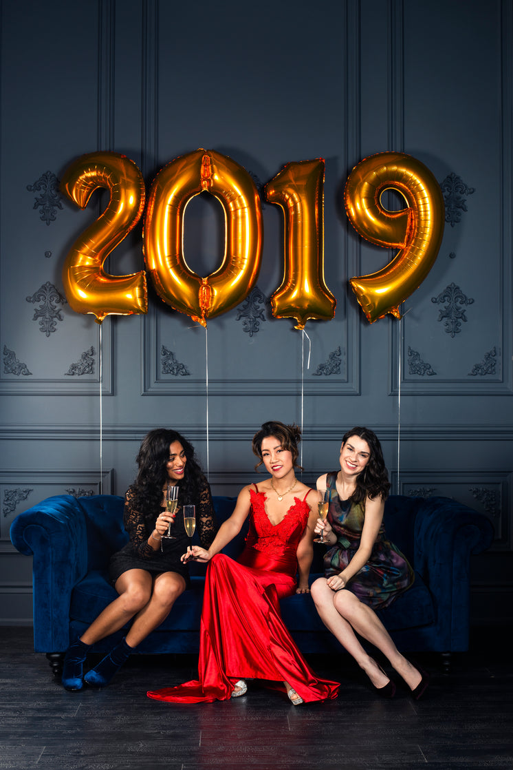 Three Woman Strike A New Year's Pose