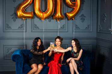 three woman toast to the new year