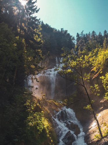 tiered waterfall on clear summer day