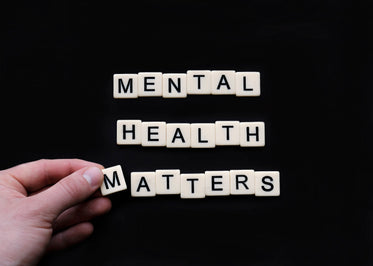 tiles lay on a black surface reading mental health matters