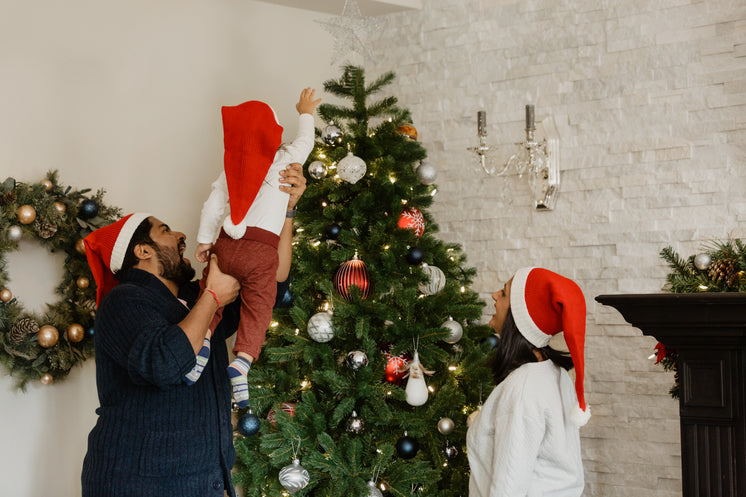 Toddler Helps Decorate The Christmas Tree