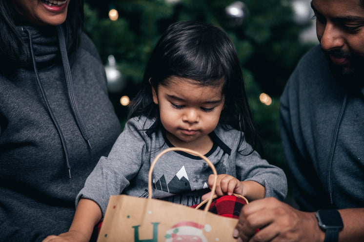Toddler Opens Christmas Presents