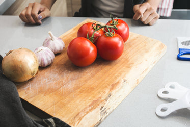 tomatoes & garlic on cutting board