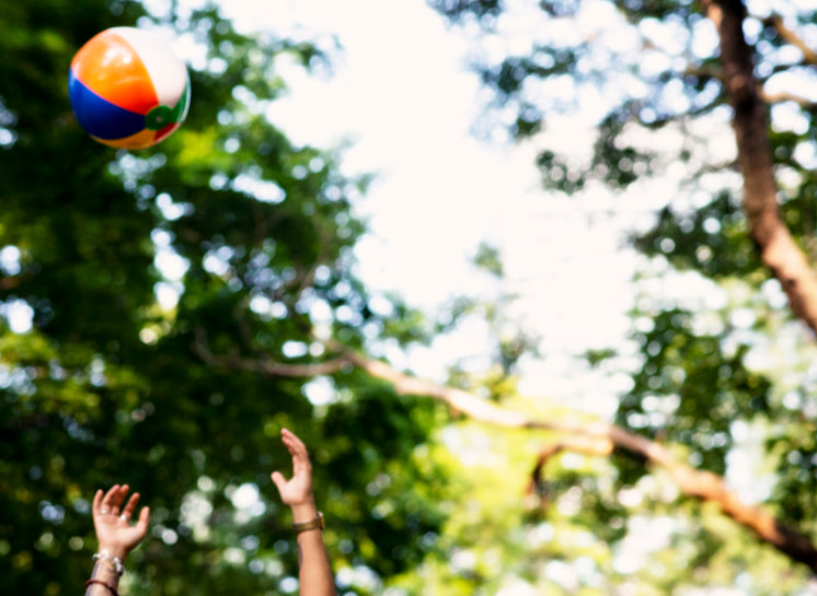 Tossing Beach Ball At The Park