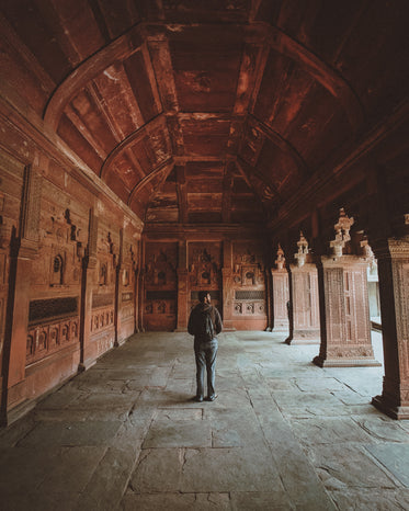 tourist in a buddhist monastery taking it all in