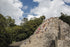 tourists climb mexican ruins