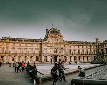 tourists snapping pics outside the louvre