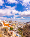 town of colorful homes on a hillside