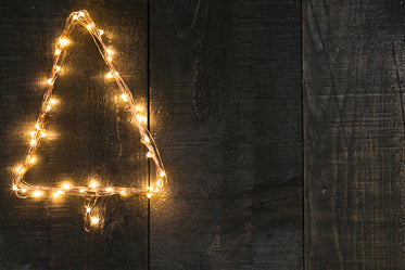 High Res Tree Shaped Lights On Woodgrain Picture — Free Images