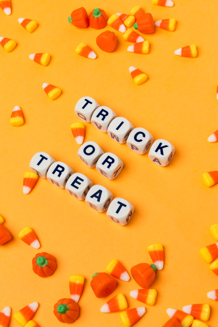 Trick Or Treat On An Orange Background With Candy Corn