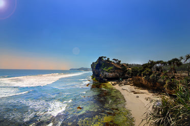 tropical sandy beach surrounded by red cliffs