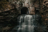tunnel opens out to waterfall