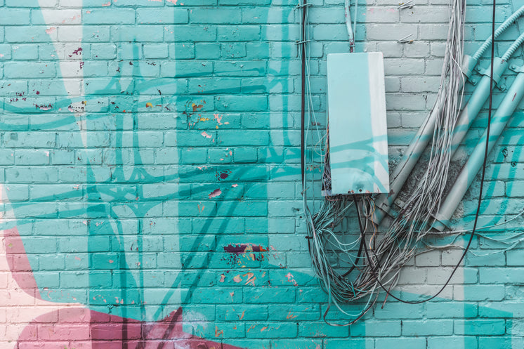 Turquoise Brick Wall With Wires