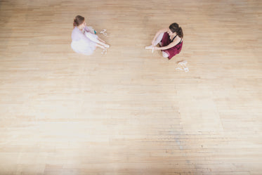two dancers prepare for ballet