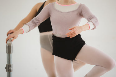 two dancers stretching
