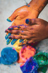 two hands rubbing powdered paint