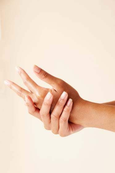 two hands running in skincare treatment