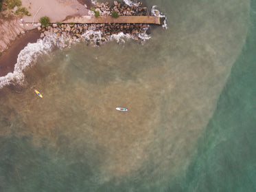 two paddleboarders coming into shore