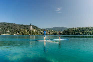 two paddleboarders on aqua blue water