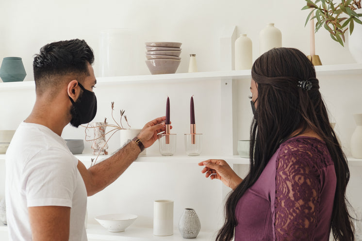 Two People Admiring A Glass Candle holder
