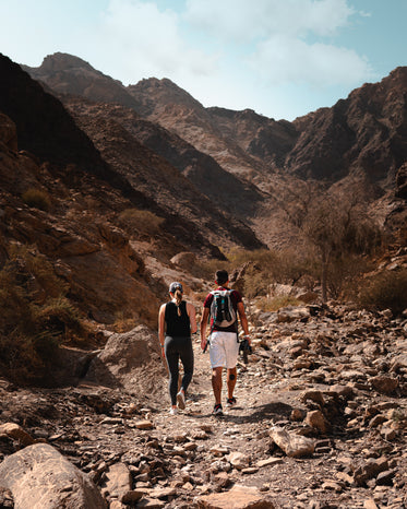 two people hiking on a rustic trail