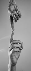 two reaching hands in black and white