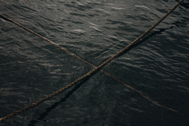 two ropes crossing over on the water