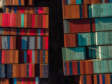 two rows of shipping containers taken with a drone