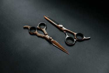 two sets of barber scissors