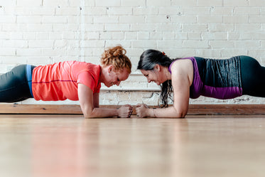 two women facing in planks